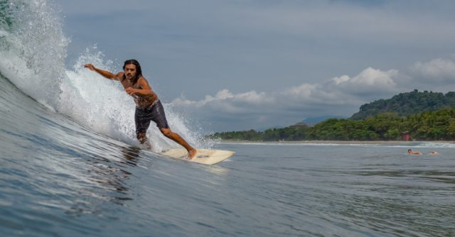 Surfing Dominical beach in Costa Rica