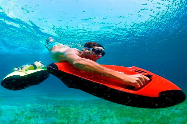 Scuba Diving with an underwater scooter